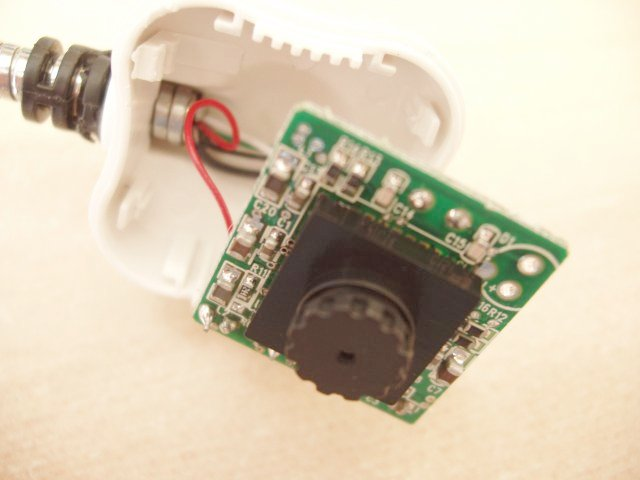 Picture showing interior of the webcam. The front of a small PCB has some surface mount components and the actual camera mounted on it.